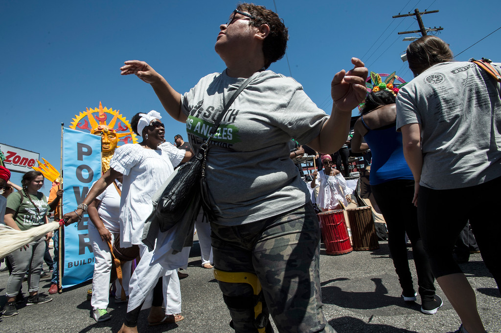 . People dance as Mama Nay Nay\'s group perform at the corner of W Florence Ave., and Normandie Ave., before the start of the march along W Florence Ave., and S Vermont Ave., on the 25th anniversary of the 1992 Los Angeles Riots during a march / rally and Future Fest community festival in South Los Angeles on Saturday, April 29, 2017. (Photo by Ed Crisostomo, Los Angeles Daily News/SCNG)