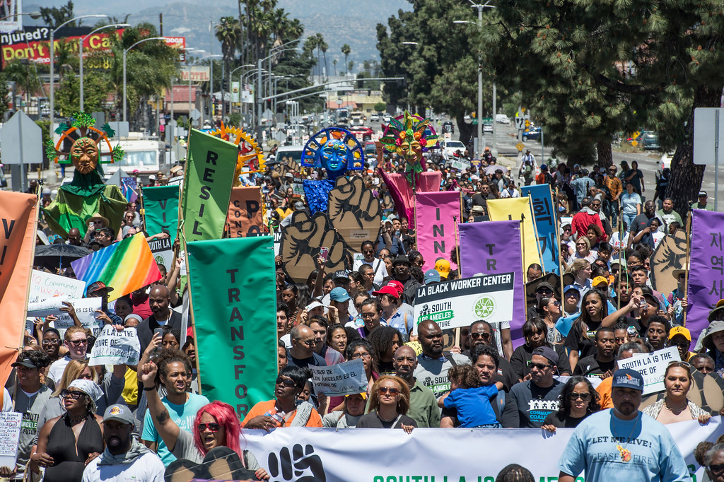 . Hundreds of people march and chant along W Florence Ave., and S Vermont Ave., on the 25th anniversary of the 1992 Los Angeles Riots during a march / rally and Future Fest community festival in South Los Angeles on Saturday, April 29, 2017. (Photo by Ed Crisostomo, Los Angeles Daily News/SCNG)