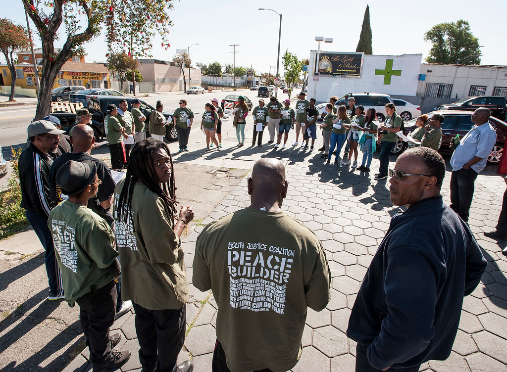 . People gather at the corner of W Florence Ave., and Normandie Ave., before the start of the march along W Florence Ave., and S Vermont Ave., on the 25th anniversary of the 1992 Los Angeles Riots during a march / rally and Future Fest community festival in South Los Angeles on Saturday, April 29, 2017. (Photo by Ed Crisostomo, Los Angeles Daily News/SCNG)