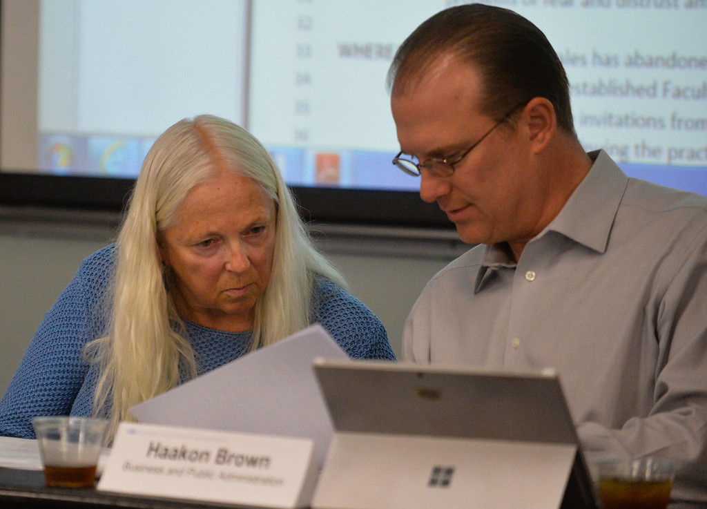 . Haakon Brown, right, speaks to Chairwoman Karen Kolehmainen, of the Cal State San Bernardino Faculty Senate, as the senate takes up a vote of no-confidence against President Tomas Morales at its meeting at Cal State San Bernardino in San Bernardino, Calif. on Tuesday, May 9, 2017. (Photo by Rachel Luna, The Sun/SCNG)