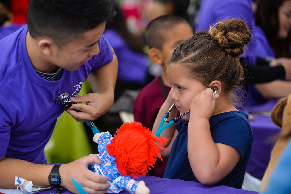 . CSUSB nursing student Christopher shows four-year-old Olivia Brown how to listen to a heartbeat through a stethoscope during the 32nd annual Children\'s Day at Loma Linda University Children\'s Hospital in Loma Linda, Calif. on Wednesday, May 10, 2017. Children were invited to learn what it\'s like to work in the medical field during the annual event. (Photo by Rachel Luna, Redlands Daily Facts/SCNG)