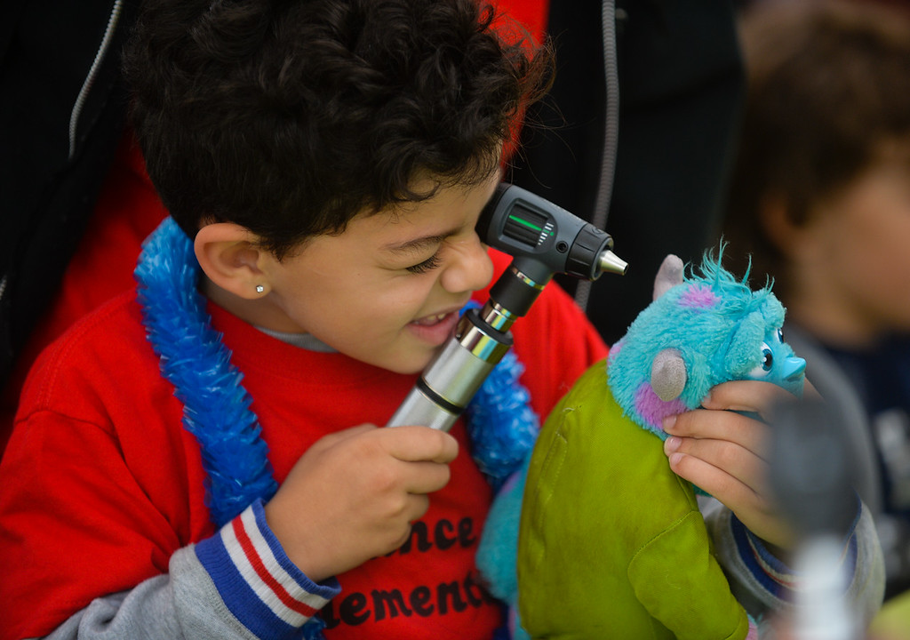 . Sundance Elementary student Rober Sansone, 6, checks his stuff animal\'s ears during the 32nd annual Children\'s Day at Loma Linda University Children\'s Hospital in Loma Linda, Calif. on Wednesday, May 10, 2017. Children were invited to learn what it\'s like to work in the medical field during the annual event. (Photo by Rachel Luna, Redlands Daily Facts/SCNG)