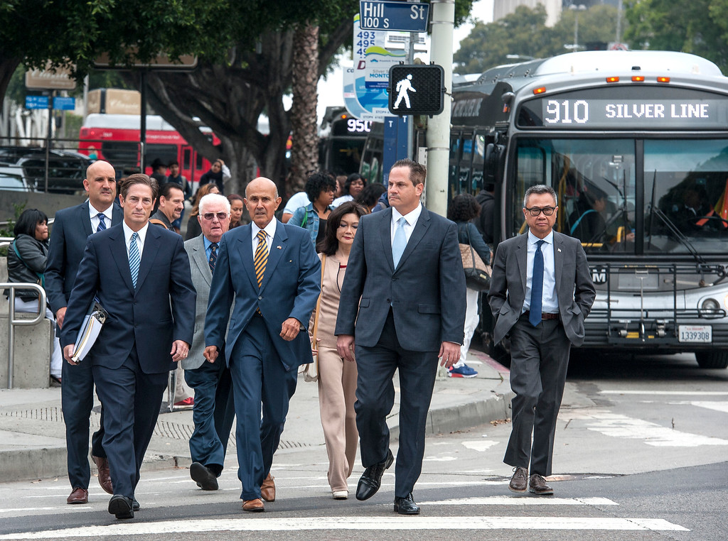 . Former LA County Sheriff Lee Baca, center, his wife Carol Chiang and his attorney Nathan Hochman, left, walk towards the Federal Courthouse in Los Angeles for the sentencing hearing on Friday, May 12, 2017. (Photo by Ed Crisostomo, Los Angeles Daily News/SCNG)