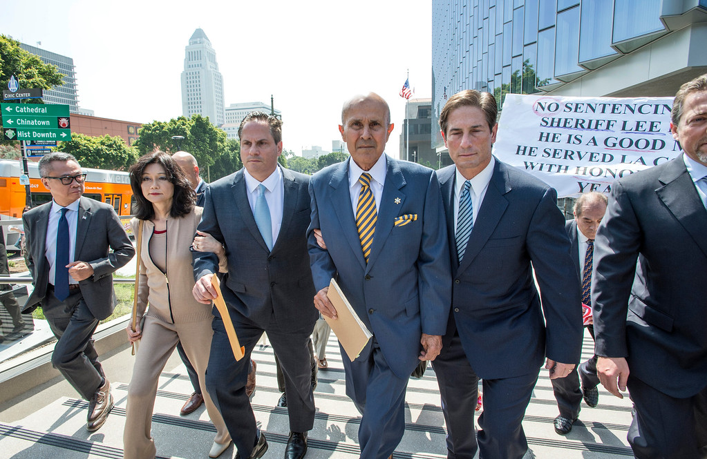 . Former LA County Sheriff Lee Baca, center, wife Carol Chiang and his attorney Nathan Hochman, right, leave the Federal Courthouse in Los Angeles after his sentencing hearing on Friday, May 12, 2017. He was sentence 36 months to federal prison. (Photo by Ed Crisostomo, Los Angeles Daily News/SCNG)