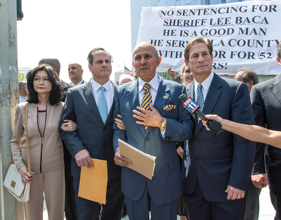 . Former LA County Sheriff Lee Baca, reacts to a question about his sentencing as his wife Carol Chiang, left, and his attorney Nathan Hochman, right, look on as they leave the Federal Courthouse in Los Angeles after his sentencing hearing on Friday, May 12, 2017. He was sentence 36 months to federal prison. (Photo by Ed Crisostomo, Los Angeles Daily News/SCNG)