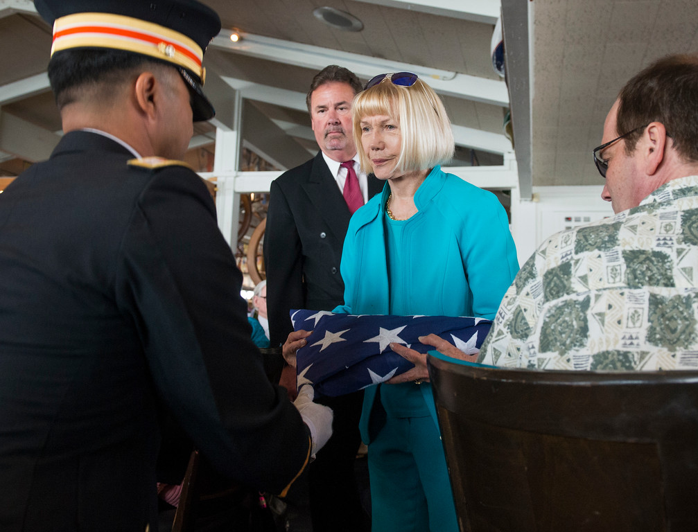 . A military honor guardsman presents the American flag to Jackie Kell at the celebration of the life for  Jackie husband Ernie Kell at the Long Beach Yacht Club in Long Beach May 11, 2017. Kell, 88, died at his home in El Dorado Park Estates on the city�s eastside after battling cancer for four months. He served as elected mayor from 1988 to 1994, winning two elections for mayor: one for a two-year term in 1988, and the second for a full, four-year term in 1990. It was a difficult period of change for Long Beach, which was on the brink of losing its naval base, downtown retail was struggling and jet-manufacturing jobs were being slashed. (Photo by Thomas R. Cordova, Press-Telegram/SCNG)