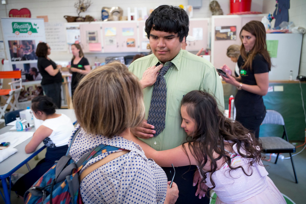 . Ben Garcia gets a hug from fellow student Hennesy Sotelo before the annual Buddy Prom, an end-of-the-year celebration of friendship for special-education students at John F. Kennedy high school in Granada Hills Thursday, May 18, 2017.  The Beauty Bus Foundation provided professional hair and makeup services to ensure to the students before the prom.  (Photo by David Crane/Los Angeles Daily News-SCNG)