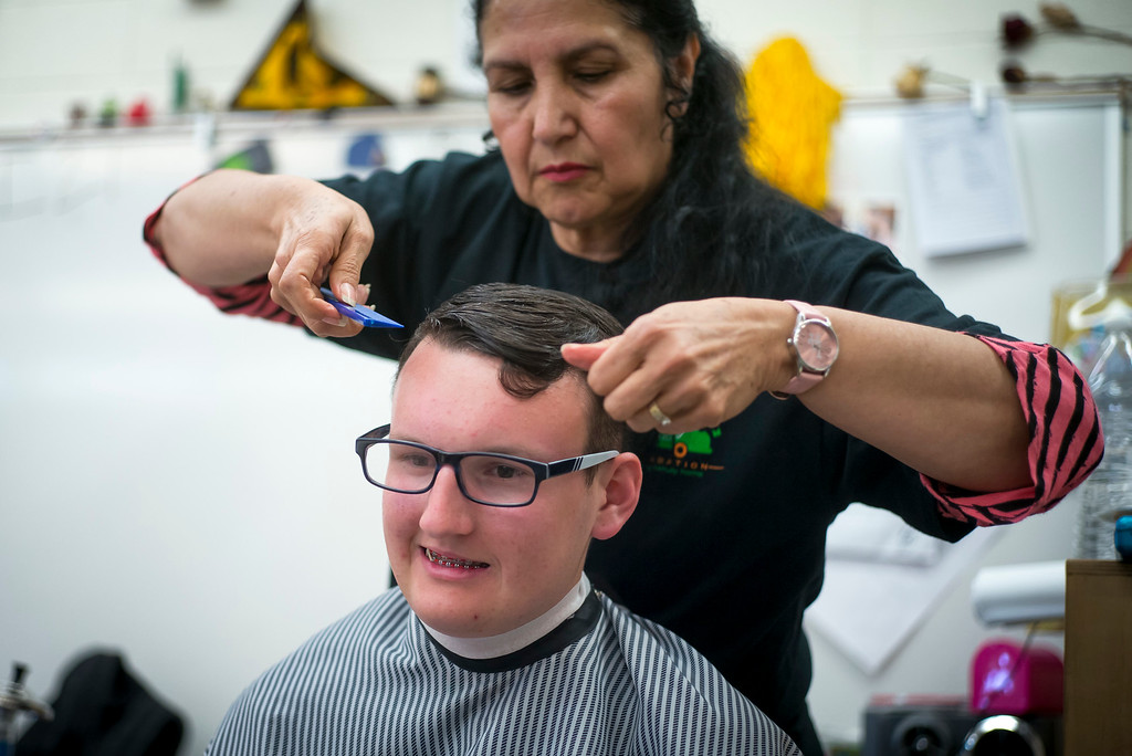 . James Dewitt gets his hair styled for the annual Buddy Prom, an end-of-the-year celebration of friendship for special-education students at John F. Kennedy high school in Granada Hills Thursday, May 18, 2017.  The Beauty Bus Foundation provided professional hair and makeup services to ensure to the students before the prom.  (Photo by David Crane/Los Angeles Daily News-SCNG)