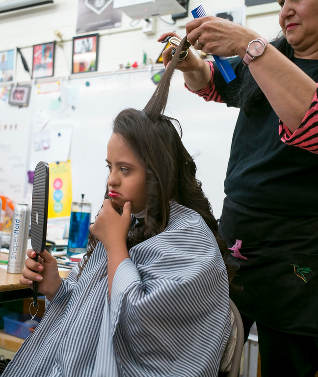 . Hennessy Sotelo checks out her hair and make-up before the annual Buddy Prom, an end-of-the-year celebration of friendship for special-education students at John F. Kennedy high school in Granada Hills Thursday, May 18, 2017.  The Beauty Bus Foundation provided professional hair and makeup services to ensure to the students before the prom.  (Photo by David Crane/Los Angeles Daily News-SCNG)