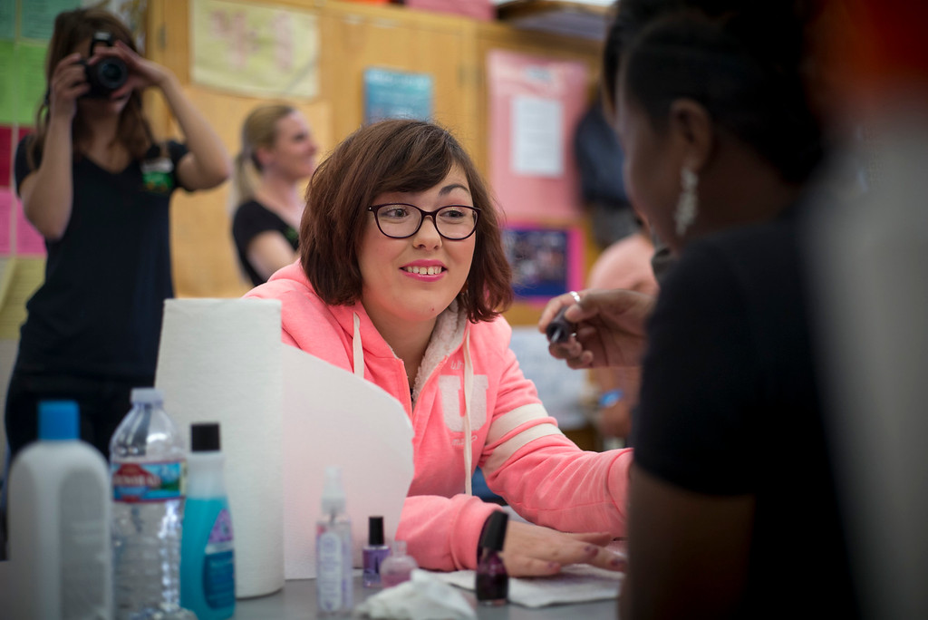 . Anastasia Khoudoiar gets her nails done for the annual Buddy Prom, an end-of-the-year celebration of friendship for special-education students at John F. Kennedy high school in Granada Hills Thursday, May 18, 2017.  The Beauty Bus Foundation provided professional hair and makeup services to ensure to the students before the prom.  (Photo by David Crane/Los Angeles Daily News-SCNG)