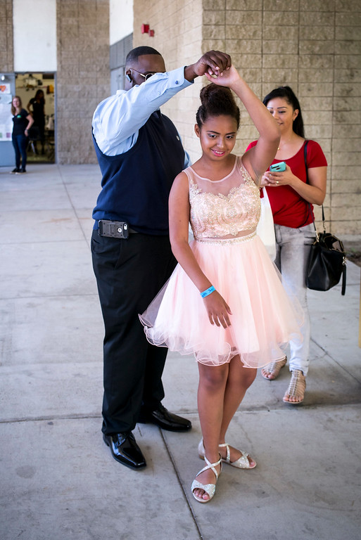 . Jennetth Jones shows off her prom dress from her mother and father, Kenneth and Thelma Jones, before the annual Buddy Prom, an end-of-the-year celebration of friendship for special-education students at John F. Kennedy high school in Granada Hills Thursday, May 18, 2017.  The Beauty Bus Foundation provided professional hair and makeup services to ensure to the students before the prom.  (Photo by David Crane/Los Angeles Daily News-SCNG)