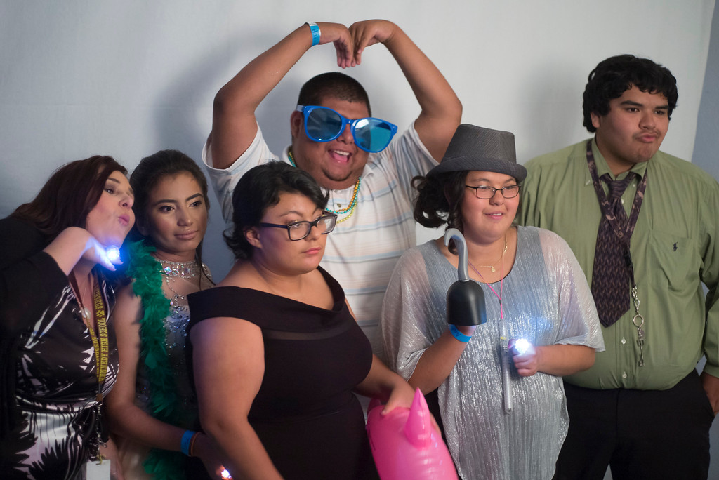 . Special Education teacher Jaymie Dean, far left, sneeks into a picture with Students in the photo booth at the annual Buddy Prom, an end-of-the-year celebration of friendship for special-education students at John F. Kennedy high school in Granada Hills Thursday, May 18, 2017.  (Photo by David Crane/Los Angeles Daily News-SCNG)
