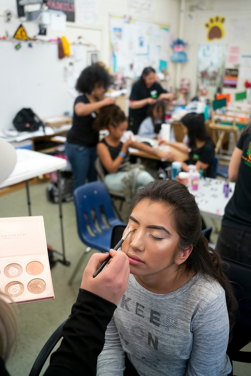 . Maria Jose Oceguera gets Make-up applied for the annual Buddy Prom, an end-of-the-year celebration of friendship for special-education students at John F. Kennedy high school in Granada Hills Thursday, May 18, 2017.  The Beauty Bus Foundation provided professional hair and makeup services to ensure to the students before the prom.  (Photo by David Crane/Los Angeles Daily News-SCNG)