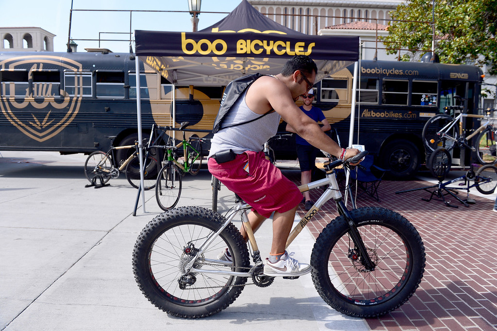 . Jonathan Wolff, of Highland Park, tries out a bamboo bike by Boo Bicycles during the Amgen Tour of California in Pasadena Saturday, May 17, 2014. (Photo by Sarah Reingewirtz/Pasadena Star-News)