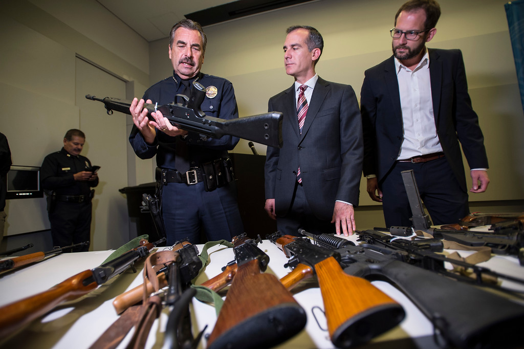 . LAPD Chief Charlie Beck holds one of the guns surrendered anonymously as Los Angeles Mayor Eric Garcetti and Ian Johnstone, right, co-founder of gunbygun, look on after a press conference announcing the results for the anonymous gun buyback at Los Angeles Police Department Headquarters in Los Angeles on Friday, May 19, 2017. (Photo by Ed Crisostomo, Los Angeles Daily News/SCNG)
