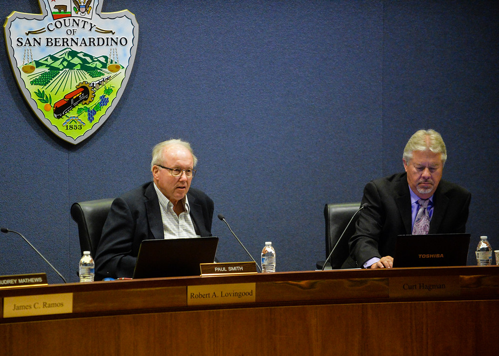 . Paul Smith, left, and and Jonathan Weldy, of the San Bernardino Planning Commission, listen to the SkyPark at Santa\'s Village expansion proposal during a San Bernardino County Planning Commission meeting at the San Bernardino County Government Administration Building in San Bernardino, Calif. on Thursday, May 18, 2017. The planning commission unanimously approved SkyPark at Santa\'s Village expansion that will include biking and other activities to make it a year-round destination. (Photo by Rachel Luna, The Sun/SCNG)