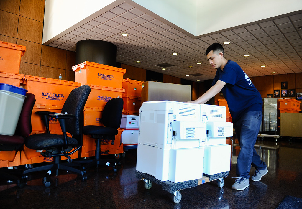 . Mover Armando Rojo moves office printers out of San Bernardino City Hall in San Bernardino, Calif. on Friday, May 19, 2017. Employees at City Hall are wrapping up their final days in the building as they prepare to move their offices elsewhere in the city. (Photo by Rachel Luna, The Sun/SCNG)