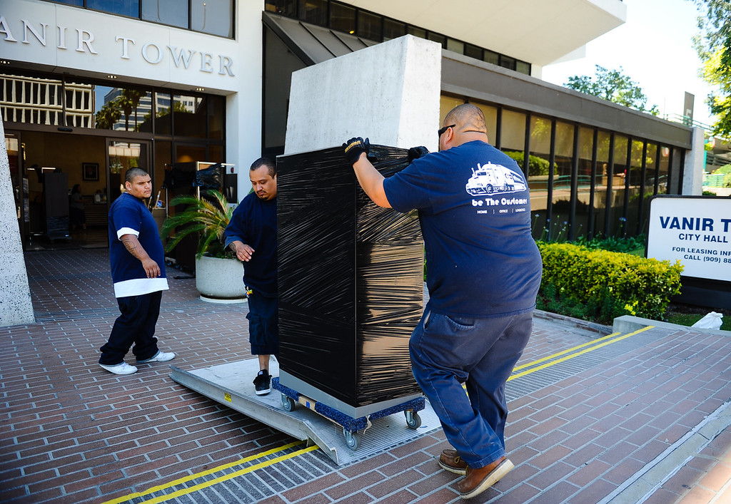 . Movers transport office furniture out of San Bernardino City Hall in San Bernardino, Calif. on Friday, May 19, 2017. Employees at City Hall are wrapping up their final days in the building as they prepare to move their offices elsewhere in the city. (Photo by Rachel Luna, The Sun/SCNG)
