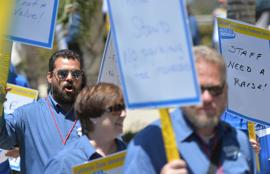. California State University Employees Union (CSUEU)  members march in a protest rally at the CSU Office of the Chancellor. The coalition is calling on CSU management take action to retain experienced employees as it finalizes its 2014-15 budget, among other concerns.  Long Beach May 20, 2014. (Photo by Brittany Murray / Daily Breeze)