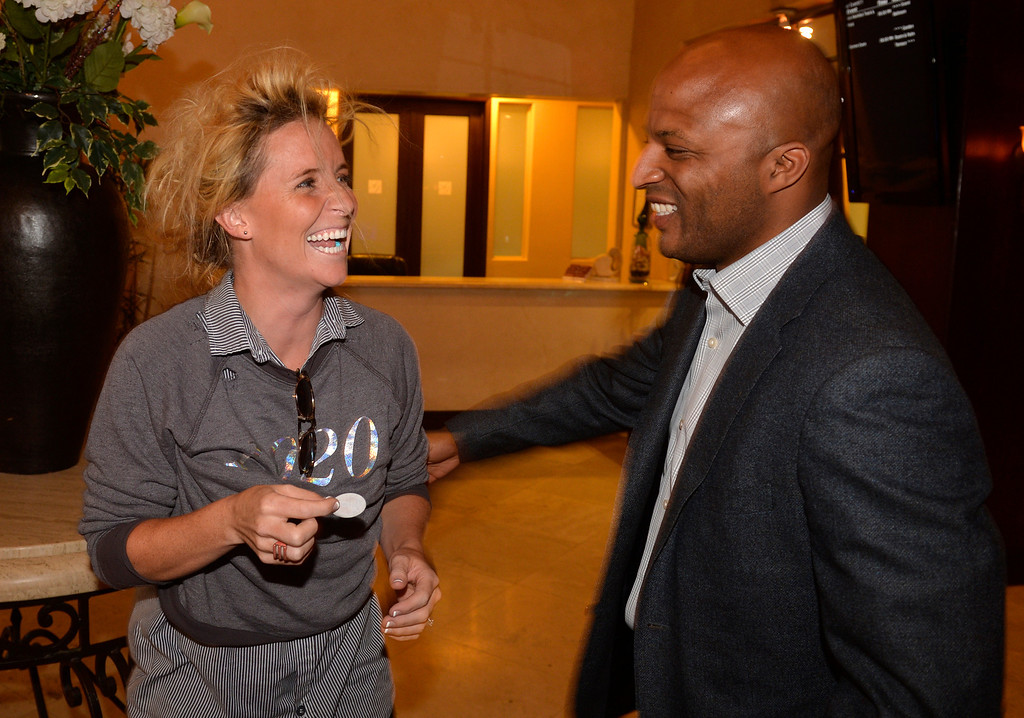 . Long Beach mayoral candidate Damon Dunn greets Megan Fate-Marshman as he welcomes gust to his party at The Grand Long Beach Event Center in Long Beach, CA. Tuesday June 3, 2014. (Thomas R. Cordova-Daily Breeze/Press-Telegram)