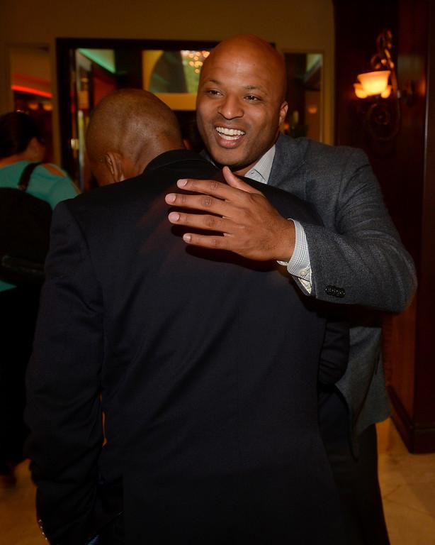 . Long Beach mayoral candidate Damon Dunn hugs Solomon Moore, of Long Beach, as he greets gust at The Grand Long Beach Event Center in Long Beach, CA. Tuesday June 3, 2014. (Thomas R. Cordova-Daily Breeze/Press-Telegram)