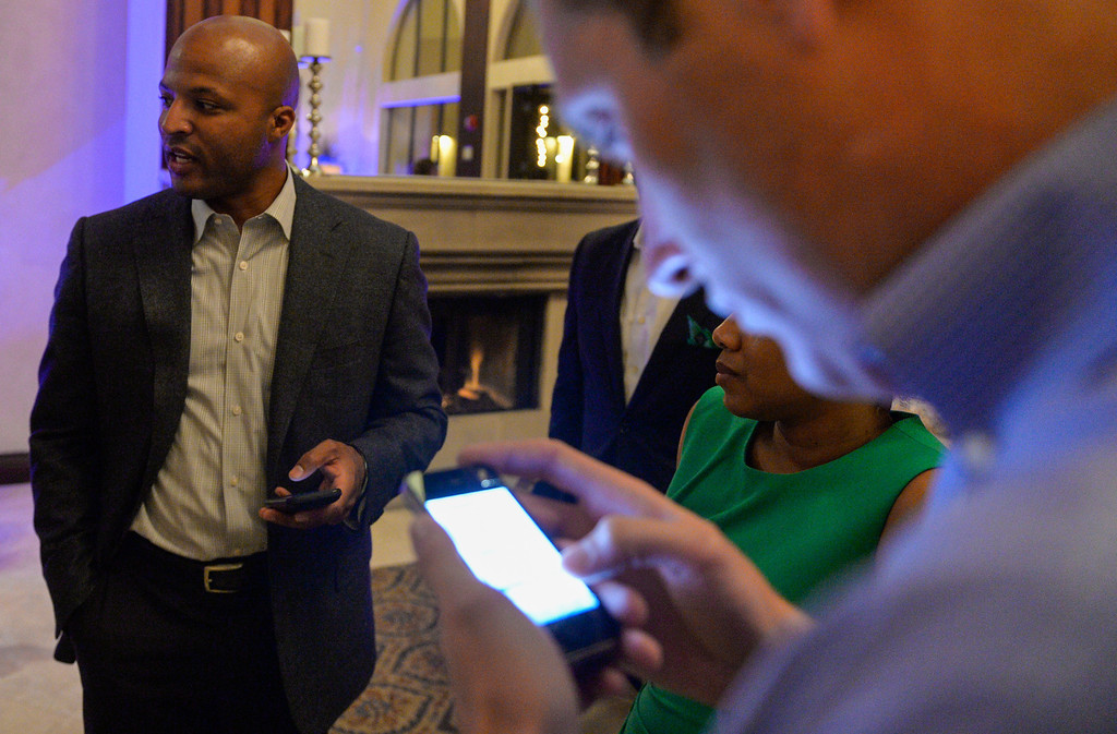 . Ian Patton, right, looks at his cell phone as results come in as he supports Long Beach mayoral candidate Damon Dunn at The Grand Long Beach Event Center in Long Beach, CA. Tuesday June 3, 2014. (Thomas R. Cordova-Daily Breeze/Press-Telegram)