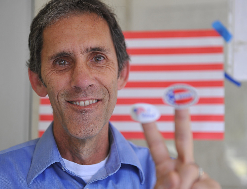 ". Joseph Godsil has double ""I voted,\"" stickers to fluant Tuesday morning after doing his civil duty at El Dorado Park.  Long Beach June 3, 2014. (Photo by Brittany Murray / Daily Breeze)"