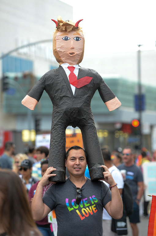 . Miguel Wevano of Pasadena carries a Donald Trump Pinata in the LA Pride Resist March Sunday, June 11, 2017.  Thousands of participants marched from Hollywood to West Hollywood for the annual LA Pride March. ( Photo by David Crane, Los Angeles Daily News/SCNG)