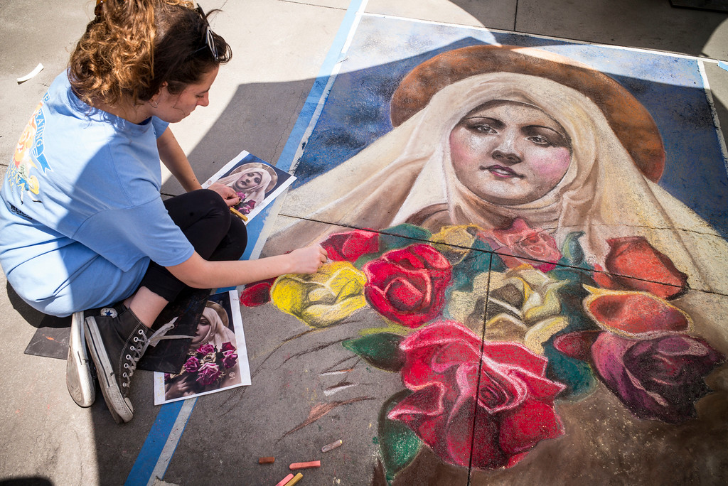 """. Artist Adriana Carovska from Macedonia works on her entry called \""""St. Therese de Lisieux\"""" at the 25th Pasadena Chalk Festival at Peseo Colorado in Pasadena Sunday, June 18, 2917.   (Photo by David Crane/Los Angeles Daily News-SCNG"""