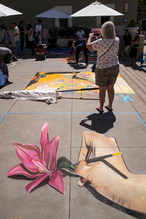 . Visitors look for new perspectives at the 25th Pasadena Chalk Festival at Peseo Colorado in Pasadena Sunday, June 18, 2017.   (Photo by David Crane/Los Angeles Daily News-SCNG