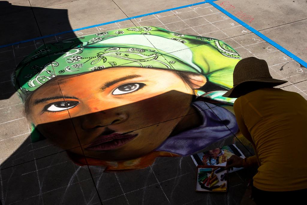 . Artist Lupita Anaya makes chalk come to life on the sidewalk at the 25th Pasadena Chalk Festival at Peseo Colorado in Pasadena.  (Photo by David Crane/Los Angeles Daily News-SCNG