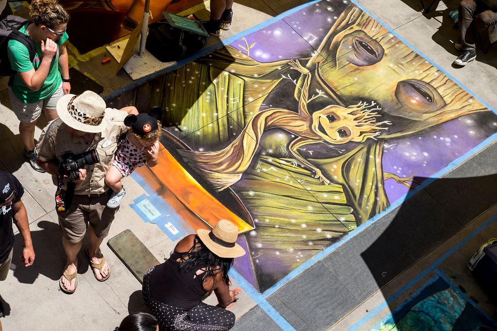 """. Artist Gus Moran made the \""""Gardians of the Galaxy\"""" come to life on the sidewalk at the 25th Pasadena Chalk Festival at Peseo Colorado in Pasadena.     (Photo by David Crane/Los Angeles Daily News-SCNG"""