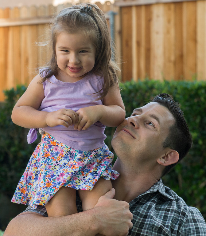 . Brad Crihfield holds his daughter, Victoria, up on his shoulder while near their home in Bellflower June 14, 2017. At the time their two-to-three months old, Victoria, was diagnosed with a rare form of cancer and given a 10 percent chance of surviving.  After chemo, radiation etc., she will be celebrating her third birthday this Saturday, a great Father\'s Day gift. Another gift is on the way this week, Brad�s wife Amanda is supposed to deliver another baby any day. (Photo by Thomas R. Cordova, Press-Telegram/SCNG)