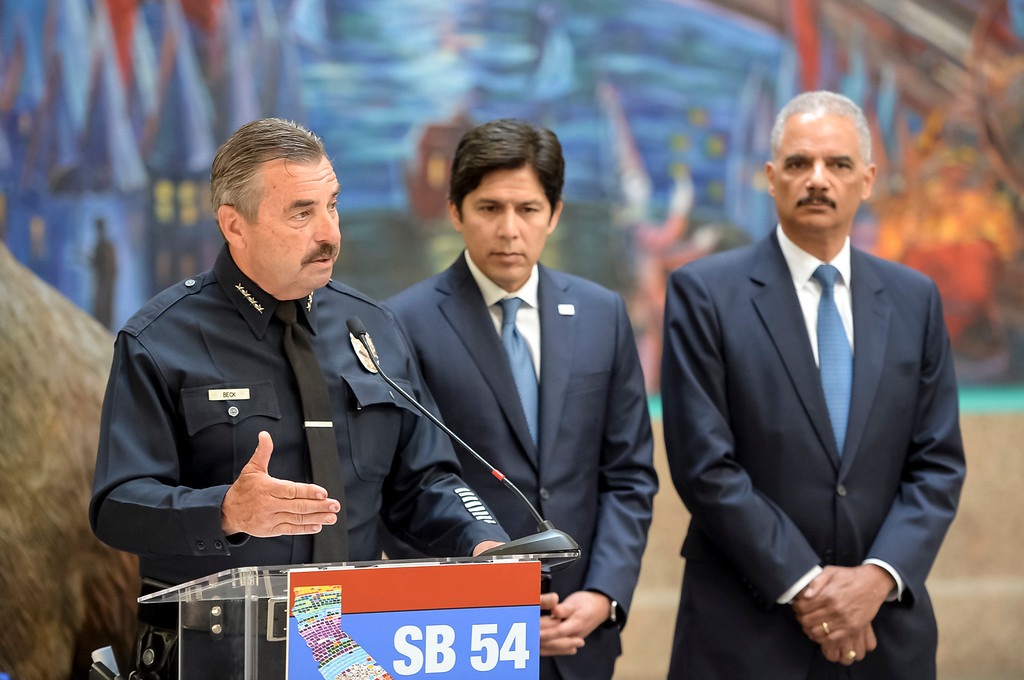 . Los Angeles Police Chief Charlie Beck, California Senate Leader Kevin de León and former U.S. Attorney General Eric Holder at a press conference in favor of SB 54 the California Values Act.    ( Photo by David Crane, Los Angeles Daily News/SCNG)