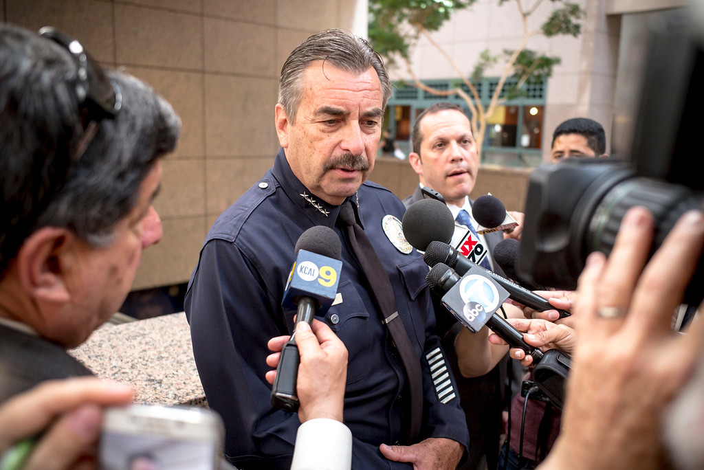 . Los Angeles Police Chief Charlie Beck is swarmed by media with questions about the stolen police vehicles by police cadets after an immigration press conference in Los Angeles Monday, June 19, 2017.     ( Photo by David Crane, Los Angeles Daily News/SCNG)