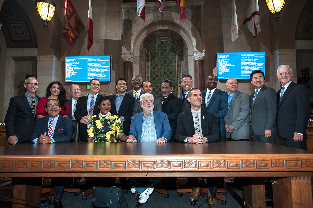 ". George Lucas, center, filmmaker, creator of ""Star Wars,\"" and his wife Mellody Hobson, board chairwoman of The Lucas Museum of Narrative Art, gather for a group photograph with Los Angeles Mayor Eric Garcetti and Los Angeles City Council members at City Hall in Los Angeles on Tuesday, June 27, 2017. The City Council approved the Lucas Museum of Narrative Art project in Exposition Park. (Photo by Ed Crisostomo, Los Angeles Daily News/SCNG)"