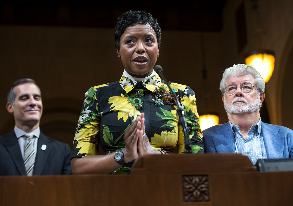 ". Mellody Hobson, center, board chairwoman of The Lucas Museum of Narrative Art, addresses the Los Angeles City Council members as her husband George Lucas, right, filmmaker, creator of ""Star Wars,\"" and Mayor Eric Garcetti look on during a meeting at City Hall in Los Angeles on Tuesday, June 27, 2017. The  City Council approved the Lucas Museum of Narrative Art project in Exposition Park. (Photo by Ed Crisostomo, Los Angeles Daily News/SCNG)"