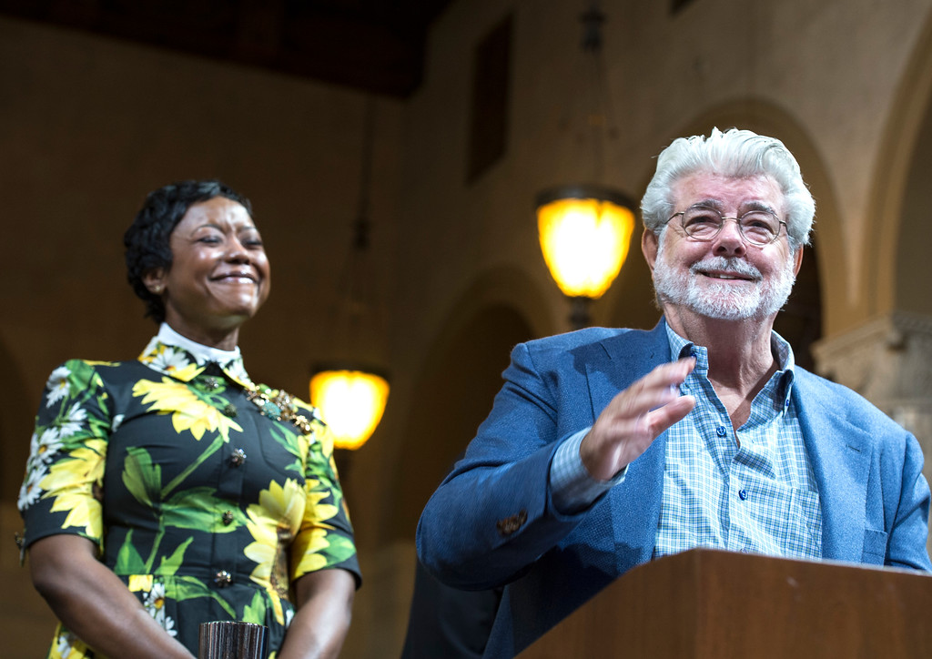 . George Lucas, right, filmmaker, creator of �Star Wars,� addresses the Los Angeles City Council members as his wife, Mellody Hobson, looks on during a meeting at City Hall in Los Angeles on Tuesday, June 27, 2017. Los Angeles City Council approved the Lucas Museum of Narrative Art project in Exposition Park. (Photo by Ed Crisostomo, Los Angeles Daily News/SCNG)