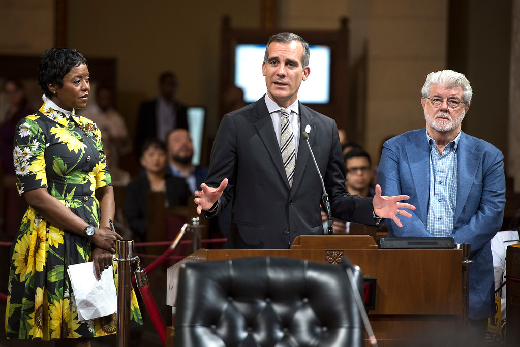 ". Los Angeles Mayor Eric Garcetti, center, addresses the L.A. City Council members as George Lucas, filmmaker, creator of ""Star Wars,\"" and Mellody Hobson, board chairwoman of The Lucas Museum of Narrative Art, look on during a meeting at City Hall in Los Angeles on Tuesday, June 27, 2017. The City Council approved the Lucas Museum of Narrative Art project in Exposition Park.  (Photo by Ed Crisostomo, Los Angeles Daily News/SCNG)"