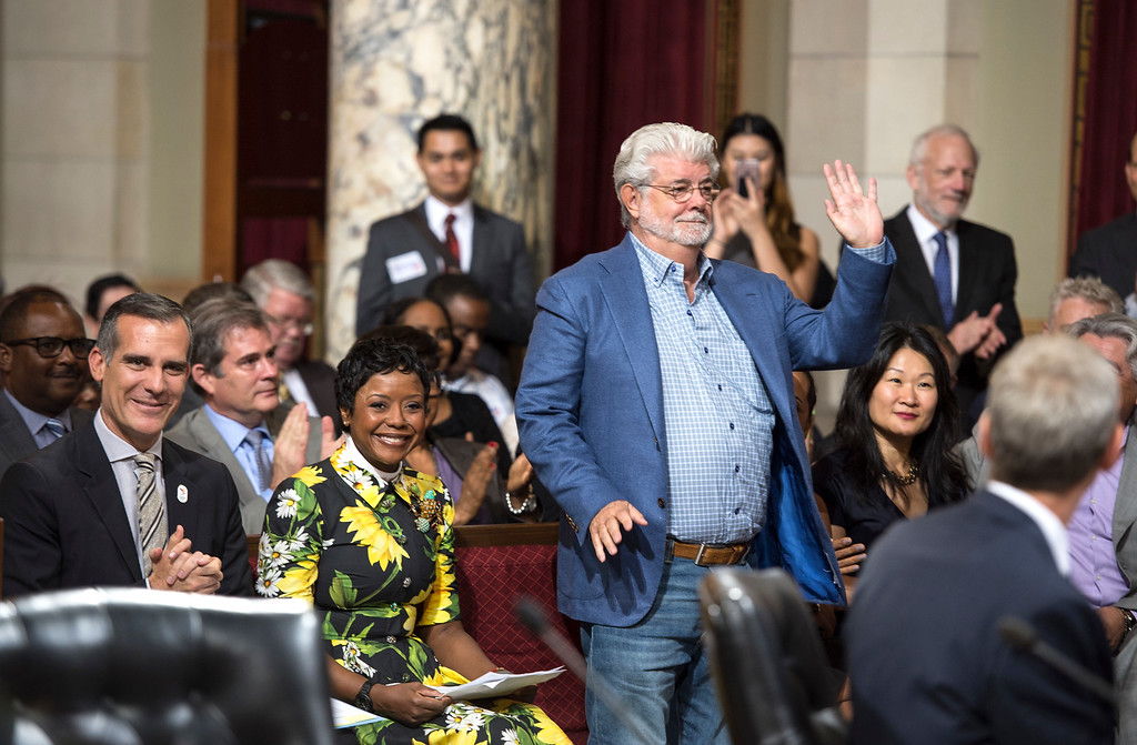 ". Los Angeles City Council members welcome George Lucas, filmmaker, creator of ""Star Wars,\"" and his wife Mellody Hobson, board chairwoman of The Lucas Museum of Narrative Art, as Mayor Eric Garcetti, left, and others give a round of applause during a meeting at City Hall in Los Angeles on Tuesday, June 27, 2017. The City Council approved the Lucas Museum of Narrative Art project in Exposition Park.  (Photo by Ed Crisostomo, Los Angeles Daily News/SCNG)"