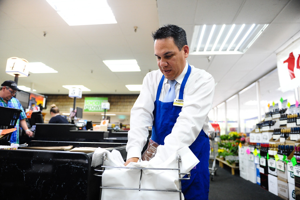 ". Rep. Pete Aguilar, D-San Bernardino, bags groceries during his ""Job for a Day\"" tour stop at Gerrards Market in Redlands, Calif. on Friday, July 7, 2017. Aguilar began the tour in April, which has taken him across the district to work different jobs at businesses through the community to connect with residents. (Photo by Rachel Luna, The Sun/SCNG)"