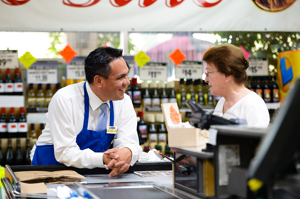 ". Rep. Pete Aguilar, D-San Bernardino, chats with Redlands resident Avis Taylor as they wait for her groceries to be rung up at the checkout stand during the congressman\'s ""Job for a Day\"" tour stop at Gerrards Market in Redlands, Calif. on Friday, July 7, 2017. Aguilar began the tour in April, which has taken him across the district to work different jobs at businesses through the community to connect with residents. (Photo by Rachel Luna, The Sun/SCNG)"
