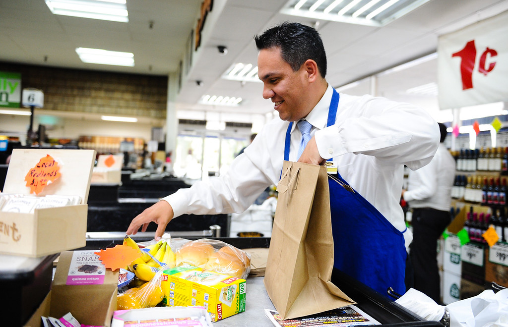 ". Rep. Pete Aguilar, D-San Bernardino, bags groceries during his ""Job for a Day\"" tour stop at Gerrards Market in Redlands, Calif. on Friday, July 7, 2017. Aguilar began the tour in April, which has taken him across the district to work different jobs at businesses throughout the community to connect with residents. (Photo by Rachel Luna, The Sun/SCNG)"