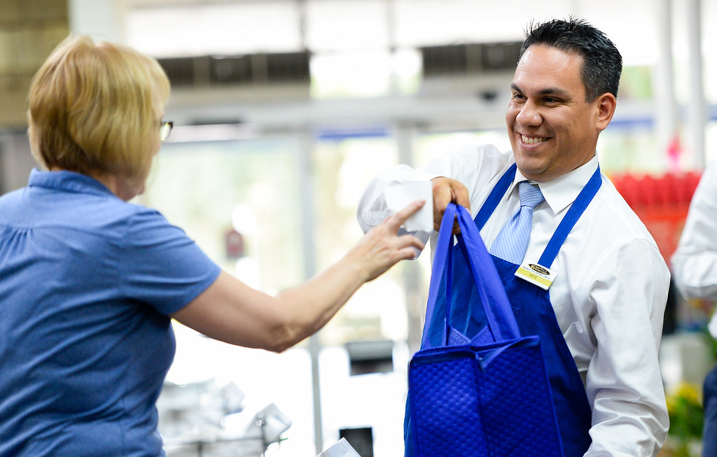 ". Rep. Pete Aguilar, D-San Bernardino, bags groceries for customers during his ""Job for a Day\"" tour stop at Gerrards Market in Redlands, Calif. on Friday, July 7, 2017. Aguilar began the tour in April, which has taken him across the district to work different jobs at businesses through the community to connect with residents. (Photo by Rachel Luna, The Sun/SCNG)"