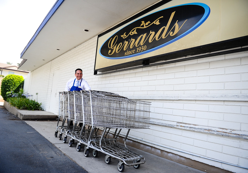 ". Rep. Pete Aguilar, D-San Bernardino, gathers grocery carts from the parking lot during his ""Job for a Day\"" tour stop at Gerrards Market in Redlands, Calif. on Friday, July 7, 2017. Aguilar began the tour in April, which has taken him across the district to work different jobs at businesses through the community to connect with residents. (Photo by Rachel Luna, The Sun/SCNG)"