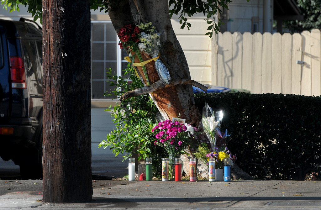 . Flowers, candles and a cross mark the site in the 20600 block of Roscoe Blvd. where an accident took the life of a young woman on Thursday, July 13, 2017.  (Photo by Dean Musgrove, Los Angeles Daily News/SCNG)