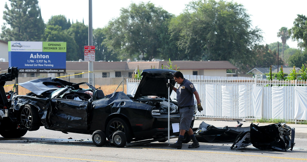 . A wrecked Dodge Challenger is seen Thursday, July 13, 2017, on Roscoe Boulevard near Irondale Avenue in Winnetka after a three-vehicle crash that left one person dead and three others injured. (Photo by Dean Musgrove/Los Angeles Daily News)