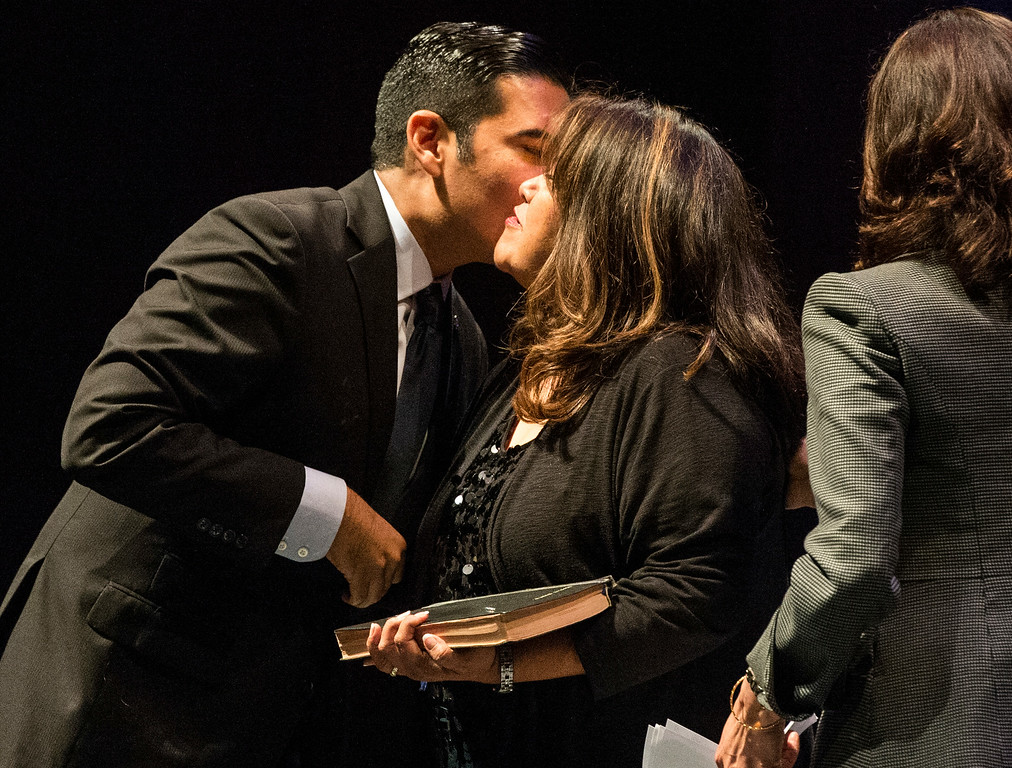 . Mayor Robert Garcia kisses his mother Gaby O\'Donnell after being sworn-in as the 28th Mayor of Long Beach at the Terrace Theater in Long Beach, CA. Tuesday July 15, 2014. (Thomas R. Cordova-Daily Breeze/Press-Telegram)