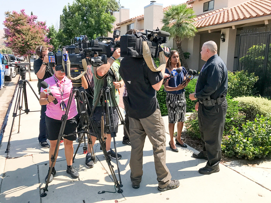 . LAPD Detective Dave Peteque meets with media outside of the Rancho Los Charcos condominium complex at 10444 Canoga avenue in Chatsworth Monday morning after two bodies were discovered around 7am in one of the units.  A gun was found at the scene. ( Photo by David Crane, Los Angeles Daily News/SCNG)