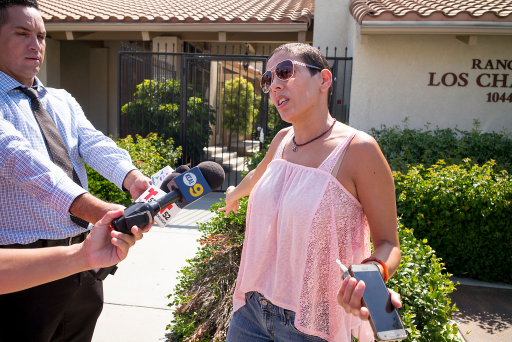 . Kathy Mendoza, a resident of the Rancho Los Charcos condominium complex at 10444 Canoga avenue in Chatsworth, says the area is quiet and safe.  Two bodies were found in one of the units around 7am Monday,  according to police, a gun was found at the scene. ( Photo by David Crane, Los Angeles Daily News/SCNG)